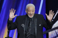 This April 18, 2015 file photo shows singer-songwriter Bill Withers speaking at the Rock and Roll Hall of Fame Induction Ceremony in Cleveland. (AP Photo/Mark Duncan)