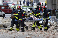 In this March 22, 2020 file photo, firefighters carry a person on a stretcher after a strong earthquake in Zagreb, Croatia. (AP Photo)