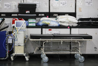 This March 23, 2020 photo shows medical supplies and a stretcher displayed before a news conference at the Jacob Javits Center in New York. (AP Photo/John Minchillo)