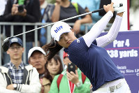 In this Oct. 31, 2019 file photo, Jin Young Ko of South Korea watches her tee shot on the first hole during the first round of the Taiwan Swinging Skirts LPGA tournament at the Miramar Golf Country Club in New Taipei City, Taiwan. (AP Photo/Chiang Ying-ying)