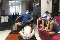 In this March 26, 2020, photo, relatives of Bella Lamilla the first person to be diagnosed with coronavirus in Ecuador, maintain quarantine in their home in Babahoyo, Ecuador. (AP Photo/Mariuxi Orellana)