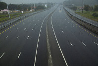 A car drives along a motorway in Johannesburg, South Africa, Saturday, April 4, 2020. (AP Photo/Themba Hadebe)