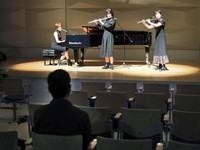 The all-female band, Sannin-Gakki, performs in front of one spectator, a man in his 30s, at a hall in the Tokyo suburban city of Tachikawa on April 4, 2020. (Mainichi/Naotsune Umemura)