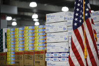 In this March 24, 2020 file photo, stacks of medical supplies are housed at the Jacob Javits Center that will become a temporary hospital in response to the COVID-19 outbreak in New York. (AP Photo/John Minchillo)