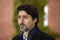 Canada's Prime Minister Justin Trudeau speaks during his daily press conference on the coronavirus pandemic outside of his residence at Rideau Cottage in Ottawa, Canada, on April 5, 2020. (Justin Tang/The Canadian Press via AP)
