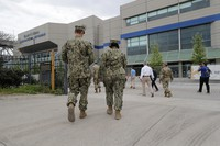 National Guard personnel walk outside the Ernest N. Morial Convention Center during a media tour of a temporary hospital that has been set up, as an overflow for local hospitals that are reaching capacity, in response to the COVID-19 pandemic, in New Orleans, on April 4, 2020. (AP Photo/Gerald Herbert)