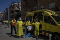 Health personnel wearing protection gear to protect against the spread of the new coronavirus prepare to attend to a patient during the COVID-19 virus outbreak in Barcelona, Spain, on April 6, 2020. (AP Photo/Emilio Morenatti)