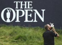 In this July 21, 2019 file photo Ireland's Shane Lowry holds and kisses the Claret Jug trophy on the 18th green as he poses for the crowd and media after winning the British Open Golf Championships at Royal Portrush in Northern Ireland. (AP Photo/Peter Morrison)