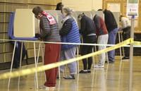 People vote at Riverside High School in Milwaukee on April 7, 2020. (Mike De Sisti/Milwaukee Journal-Sentinel via AP)