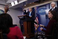 In this April 7, 2020 photo, U.S. President Donald Trump calls on a reporter for a question as he speaks about the coronavirus in the James Brady Press Briefing Room of the White House in Washington. (AP Photo/Alex Brandon)
