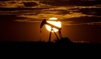 The sun sets behind an idle pump jack near Karnes City in Texas, on April 8, 2020. (AP Photo/Eric Gay)