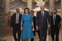 In this March 13, 2020 photo, U.S. Speaker of the House Nancy Pelosi, D-Calif., and Majority Leader Steny Hoyer, D-Md., arrive to make a statement ahead of a planned late-night vote on the coronavirus aid package deal, at the Capitol in Washington. (AP Photo/J. Scott Applewhite)