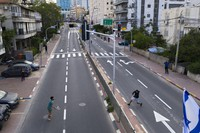 Israelis play tennis on an empty road during lockdown following the government's measures to help stop the spread of the coronavirus, in Ramat Gan, near Tel Aviv, Israel, on April 9, 2020. (AP Photo/Oded Balilty)