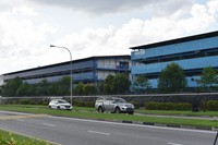 Vehicles pass the S11@Punggol foreign worker's dormitory compound, on April 17, 2020 in Singapore. The city state is the latest Southeast Asian nation to surpass 5,000 COVID-19 cases, after more than 600 new cases were reported Friday. The health ministry said most of the new cases are foreign workers living in crowded dormitories. (AP Photo/YK Chan)