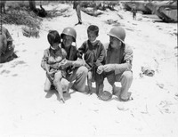 Children believed to have been taken into protective custody of the U.S. military are pictured in this photo taken by the U.S. military on Saipan in June 1944. They appear to have bandages around their necks. (Photo courtesy of the Okinawa Prefectural Archives)