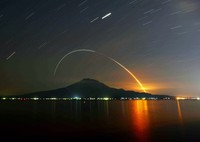 Traces of moving light are seen from the last H2B rocket carrying the Japan Aerospace Exploration Agency's Kounotori 9 unmanned cargo vessel as it flies over Sakurajima Island off the city of Kagoshima, southwestern Japan, for the International Space Station before dawn on May 21, 2020 in this photo exposed for 15 minutes. (Mainichi/Osamu Sukagawa)