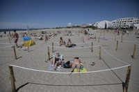 Sunbathers lie in an area marked to enforce social distancing measures in La Grande Motte, southern France, on May 24, 2020. (AP Photo/Daniel Cole)
