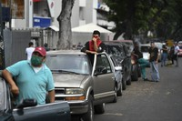Drivers wait for hours to fill up with gasoline at a state oil company PDVSA gas station in Caracas, Venezuela, on May 25, 2020. (AP Photo/Matias Delacroix)