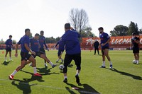 In this photo provided by Atletico Madrid, team players take part in the first group training session in Madrid, Spain, on May 18, 2020. (Atletico de Madrid via AP)
