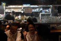 A clear plastic curtain is installed between the cooking area and the counter where customers sit to prevent the spread of the novel coronavirus at a yakitori restaurant in Tokyo's Shinjuku Ward on May 26, 2020. (Mainichi/Kimi Takeuchi)