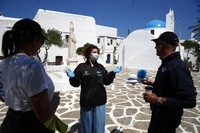 In this May 25, 2020 photo, a doctor of the Public Health Organization (EODY), center, speaks with the members of the Nonprofit Organization Symplefsi after she has tested local residents for the new coronavirus, on the Aegean Sea island of Sikinos, Greece. (AP Photo/Thanassis Stavrakis)