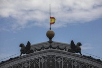 A Spanish flag hoisted to half-staff for the victims of COVID-19, flutters atop of the dome of the Atocha train station in Madrid, Spain, on May 26, 2020. (AP Photo/Bernat Armangue)