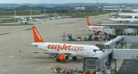 In this June 11, 2013 file photo, easyJet passenger jets are seen on the tarmac at Orly airport, west of Paris, France. (AP Photo/Jacques Brinon)