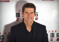 In this Aug. 29, 2018 file photo, Tom Cruise poses for photos during a red carpet event for the movie