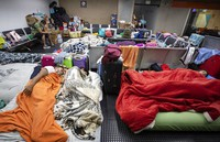 Stranded Colombians sleep inside the Sao Paulo international airport while flights are severely limited during the COVID-19 pandemic in Guarulhos, Brazil, on May 27, 2020. (AP Photo/Andre Penner)