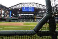 A view of Globe Life Field, the newly built home of the Texas Rangers, with the roof open from a perspective along the third base line is shown in Arlington, Texas, on May 20, 2020. The large video screen at the top of the stadium shows upcoming high school graduation ceremonies for the class of 2020 to be held at the park. The Rangers were supposed to have their home opener on March 31, against the Los Angeles Angels, but have yet to see one game played in it this season amid the coronavirus pandemic. (AP Photo/Tony Gutierrez)