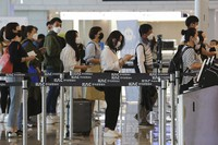 Passengers wearing face masks line up to board their planes at the domestic flight terminal of Gimpo airport in Seoul, South Korea, on May 27, 2020. The quarantine authorities began to require all airplane passengers to wear masks amid the coronavirus pandemic. (AP Photo/Ahn Young-joon)