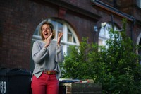 Annemarie Plas, a Dutch national who created the weekly 8pm Clap For Our Carers, stands with other residents in south London, as she joins the applause to salute local heroes during nationwide Clap for Carers to recognise and support NHS workers and carers fighting the coronavirus pandemic, in South London, on May 28, 2020. (Aaron Chown/PA via AP)