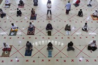 Muslims pray spaced apart to help curb the spread of the coronavirus during a Friday prayer at the Al Barkah Grand Mosque in Bekasi on the outskirts of Jakarta in Indonesia, on May 29, 2020. (AP Photo/Achmad Ibrahim)