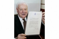 In this Nov. 7, 2005 file photo, former Australian Prime Minister Gough Whitlam shows the original copy of the dismissal letter he received from then Governor-General Sir John Kerr on Nov. 11, 1975, at a book launch in Sydney, Australia. (AP Photo/Mark Baker)