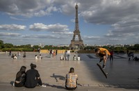 People stroll at Trocadero square near the Eiffel Tower in Paris, on May 25, 2020, as France gradually lifts its Covid-19 lockdown. (AP Photo/Michel Euler)