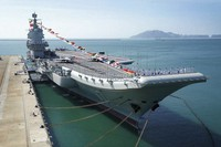 In this Dec. 17, 2019, file photo provided by Xinhua News Agency, the Shandong aircraft carrier is docked at a naval port in Sanya in southern China's Hainan Province. China's Defense Ministry said on May 29, 2020, the navy's only entirely home-built aircraft is carrying out sea trials to test weapons and equipment and enhance training of the crew. (Li Gang/Xinhua via AP)