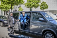 Chancellor Angela Merkel steps out of a minibus as she arrives for a parliament session at the Reichstag building in Berlin, Germany, on May 29, 2020. Because of the coronavirus crisis the Merkel was chauffeured in a minibus in order to keep the distancing rules. (Michael Kappeler/dpa via AP)
