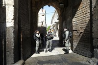 Israeli police officers secure the area of Lion's gate in Jerusalem's Old City, on May 30, 2020. Israeli police shot dead a Palestinian near Jerusalem's Old City who they had suspected was carrying a weapon but turned out to be unarmed. (AP Photo/Mahmoud Illean)