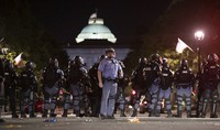 Raleigh Police block Fayetteville Street at Hargett Street as they work to return order after a night of violent demonstrations early Sunday, May 31, 2020, in Raleigh, N.C. (Robert Willett/The News & Observer via AP)