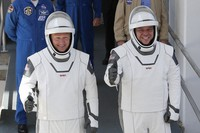 NASA astronauts Douglas Hurley, left, and Robert Behnken walk out of the Neil A. Armstrong Operations and Checkout Building on their way to Pad 39-A, at the Kennedy Space Center in Cape Canaveral, Fla., on May 30, 2020. (AP Photo/John Raoux)