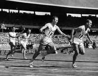 In this Nov. 30, 1956, file photo, Thane Baker, of the United States, hands to Bobby Joe Morrow for the last baton change in the first heat of the first round of the 4 x 100 meters Summer Olympic Games relay event in Melbourne, Australia. (AP Photo/Pool)