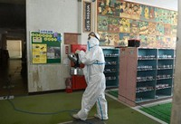 A special worker is seen disinfecting the Moritsune Elementary School building, where a cluster infection is thought to have taken place, in Kitakyushu on May 29, 2020. (Mainichi/Noriko Tokuno)