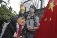 Pro-China supporters hold the effigy of U.S. President Donald Trump and Chinese national flag outside the U.S. Consulate during a protest in Hong Kong, on May 30, 2020. (AP Photo/Kin Cheung)