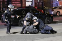 Police officers tackle a suspect trying to escape in New York, on June 1, 2020. (AP Photo/Seth Wenig)