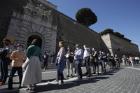 Visitors line up to enter the Vatican Museums on their reopening date, in Rome, on June 1, 2020. (AP Photo/Alessandra Tarantino)