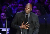 In this Feb. 24, 2020 file photo, former NBA player Michael Jordan reacts while speaking during a celebration of life for Kobe Bryant and his daughter Gianna in Los Angeles. (AP Photo/Marcio Jose Sanchez)