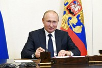 Russian President Vladimir Putin, attends a meeting via teleconference at the Novo-Ogaryovo residence outside Moscow, Russia, on June 1, 2020. Putin set a nationwide vote on constitutional amendments allowing him to extend his rule for July 1. (Alexei Nikolsky, Sputnik, Kremlin Pool Photo via AP)