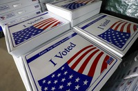 A stack of table top voting booths is stored for Tuesday's primary at the Allegheny County Election Division's warehouse on the Northside of Pittsburgh, on June 1, 2020. (AP Photo/Gene J. Puskar)