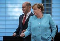 German Chancellor Angela Merkel, right, and German Finance Minister Olaf Scholz attend the weekly cabinet meeting at the Chancellery in Berlin, Germany, on June 3, 2020. (Michael Kappeler/DPA via AP, Pool)