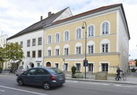 This Sept. 27, 2012 file picture shows an exterior view of Adolf Hitler's birth house, front, in Braunau am Inn, Austria. The birth house of Adolf Hitler will become a police station Austrian interior minister Karl Nehammer said, as he presents the redesign of the building at a news conference in Vienna on June 2, 2020. (AP Photo/Kerstin Joensson)